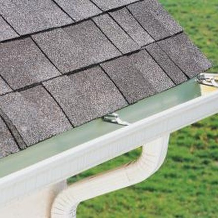 Replacing fascia boards may require that you remove the gutters.