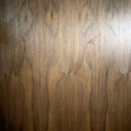 Use a wood-graining tool to faux finish a metal door.
