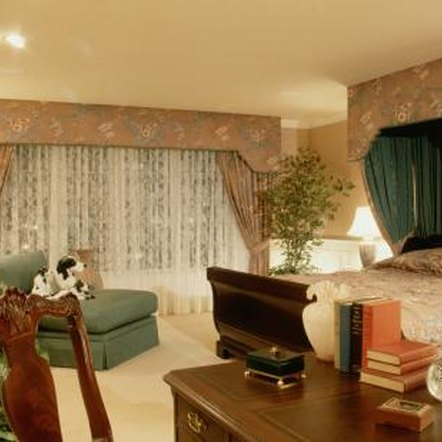 Curtains installed on the wall behind the bed provide a nice backdrop to emphasise this focal point.