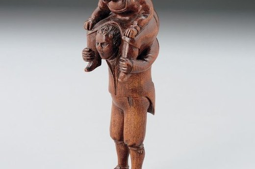 Man with Woman on Shoulders