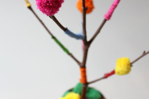 Glue Pom Poms to the Branch