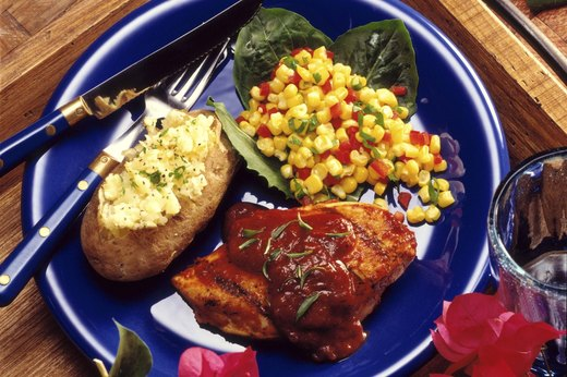 Barbecue Chicken with Baked Potato and Corn