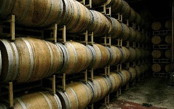 Some wine varieties age in oak barrels, while others ferment in large stainless steel tanks.