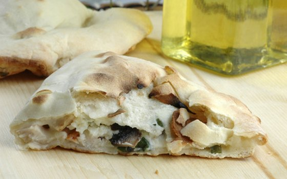 Calzones are large and filling lunches for travelers on a budget.