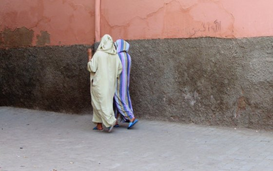 Moroccan women typically dress modestly, even in more open-minded Marrakech.