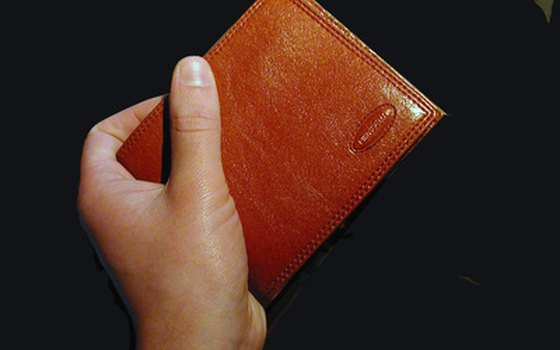 Keep your wallet in an inside pocket or wear a money belt.