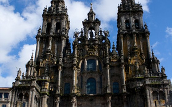 Tourists and pilgrims flock to the Cathedral of Santiago de Compostela for the summertime Feast of St. James.