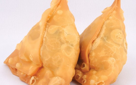 Fried meat and vegetable samosas have been integrated into Tanzanian cuisine.