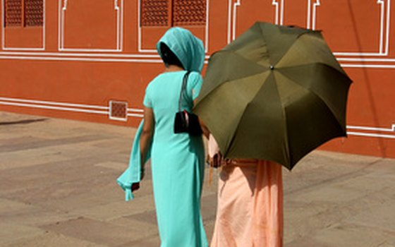 Two women wearing shalwar kameez