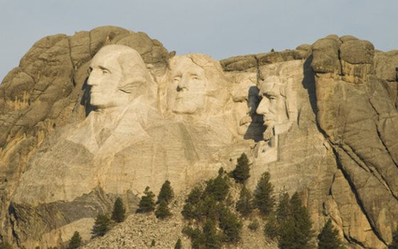 See the faces of the presidents at Mount Rushmore.