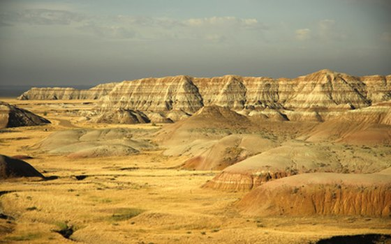 Badlands topography is often encountered in areas with erodable rock layers, scant precipitation and little vegetation.