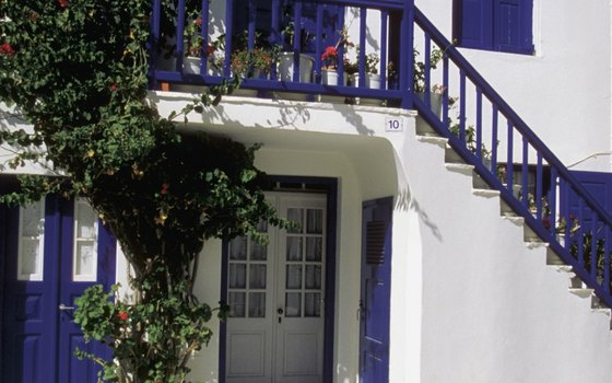 Mykonos is an idyllic Greek island that features blue and white houses.