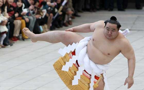On January 1, sumo grand champions help celebrate the new year at temples around Tokyo.