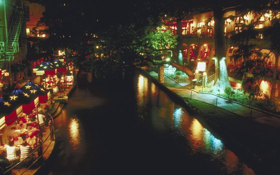 San Antonio's famous Riverwalk lights up at night for annual holiday parades.