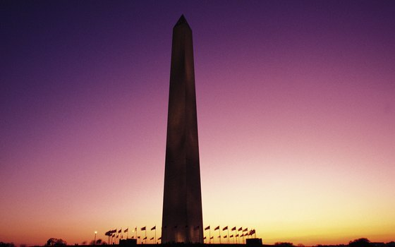 The Washington Monument is surrounded by U.S. flags.