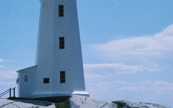 Peggy's Cove Lighthouse guides navigators through dangerous waters.
