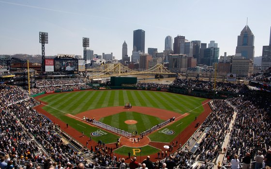 PNC Park sits on the Allegheny River, with views of Pittsburgh's skyscrapers beyond the field.