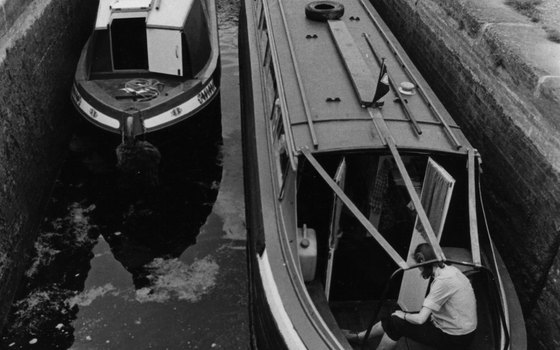 Two boats show off their narrowness.