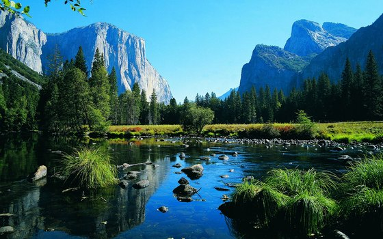 The contrast of the Yosemite Valley's mirrored lakes and granite mountain peaks in California make a spectacular sight.