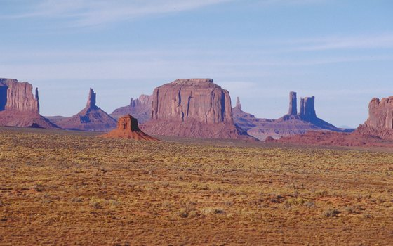 Monument Valley contains mesas, buttes and pillars.