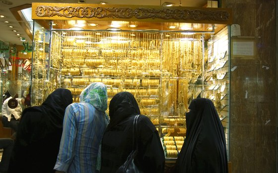 Visit a gold souk and experience the haggling over price.