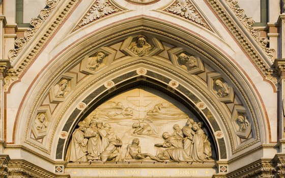 Friezes depicting biblical scenes line the facade of Santa Croce.