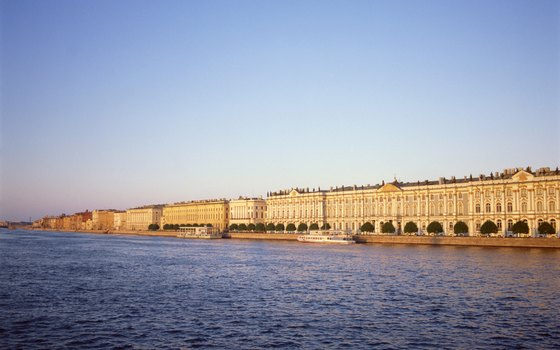 The massive Winter Palace sits at the edge of the Neva River.