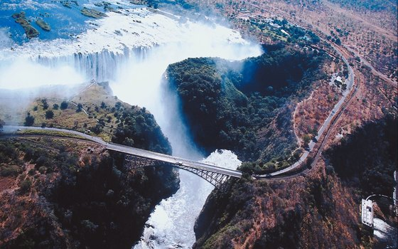 Victoria Falls Bridge crosses the Zambezi River at the second gorge from the falls.