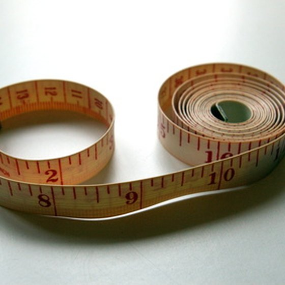 Use a sewing tape measure to take leg measurements for compression stockings.