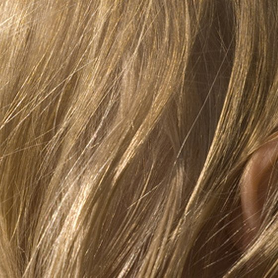 Head lice live in the hair and feed on the blood in the scalp.
