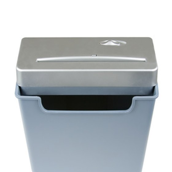 Office shredders reduce confidential records to unreadable scrap.