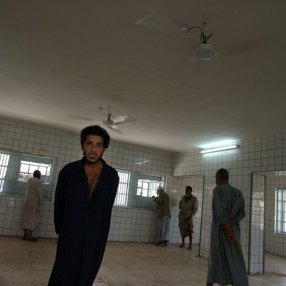 Male patients standing in room of psychiatric hospital