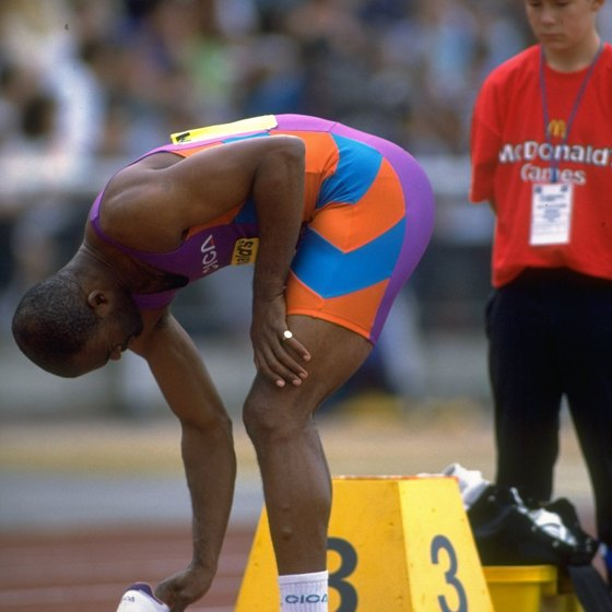 Kriss Akabusi, former Olympic medalist and UK hurdling champ wore pink slippers between races to preserve his spikes.