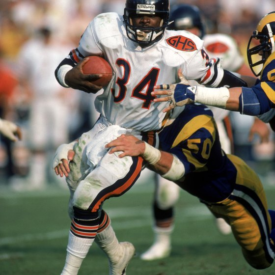 Former Bears running back Walter Payton breaks a tackle.