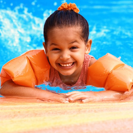Incorporate lots of colorful props into your swim lessons.