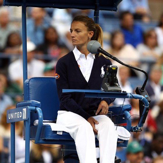 A chair umpire enforces rules at the 2011 U.S. Open.