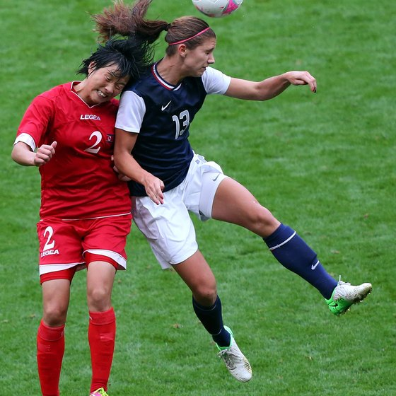 A leaping Alex Morgan displays the fitness of the U.S. women's soccer team in the 2012 Olympics.