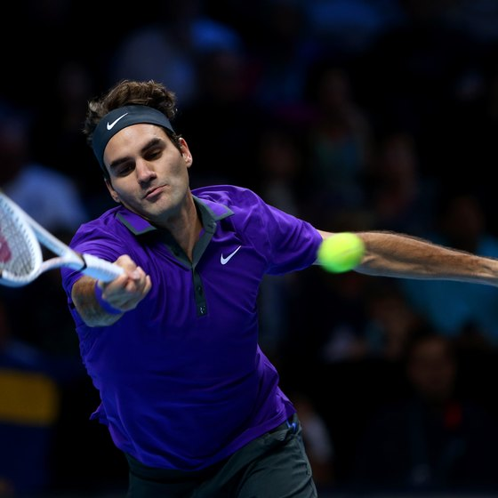 Roger Federer reaches for a forehand return.