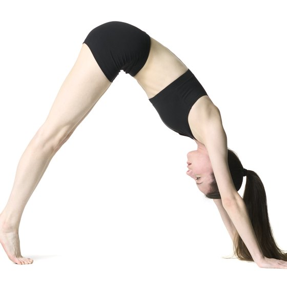 The downward-facing dog pose can firm and tighten your entire leg and buttock area.