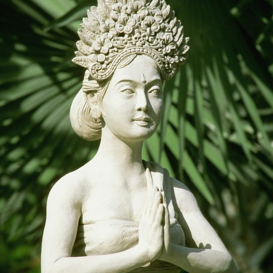 An Indonesian statue demonstrates the Namaste hand position.