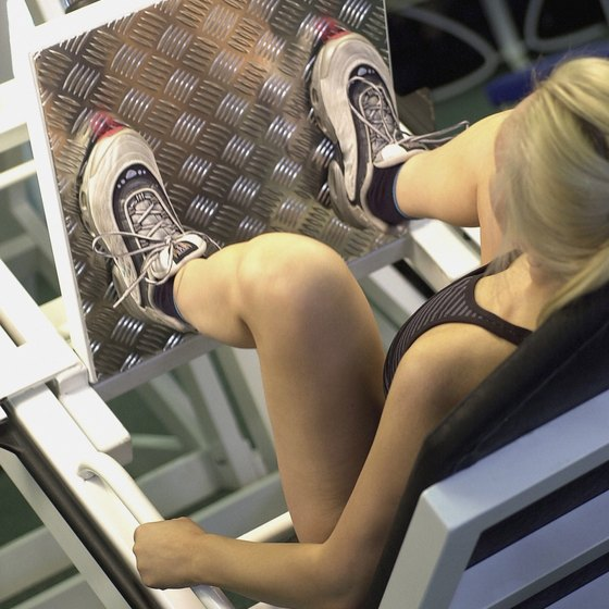 A leg press machine builds thigh muscles.