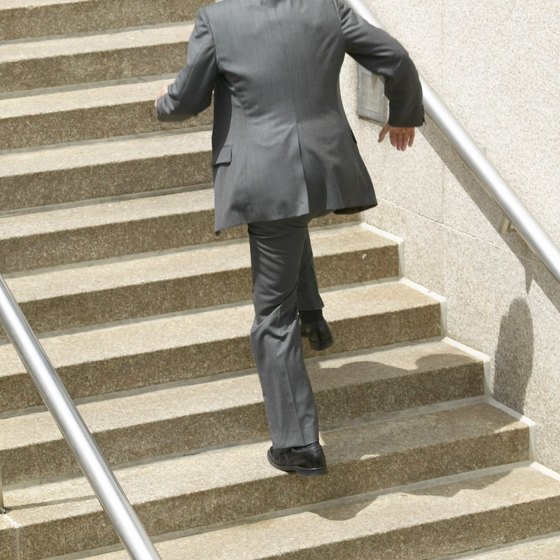 Use your staircase at work for a cardio workout when you can't get to the gym.