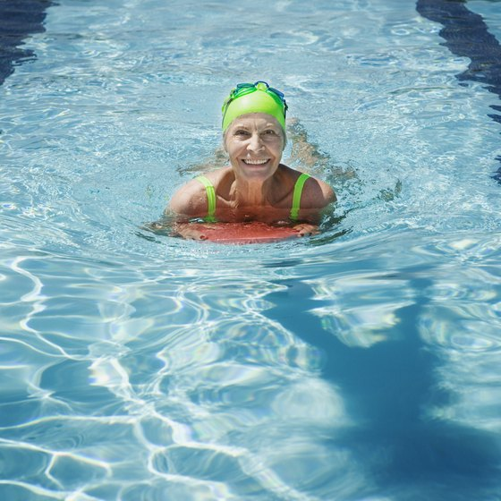 Use a kickboard during your swimming exercises to isolate the leg muscles.