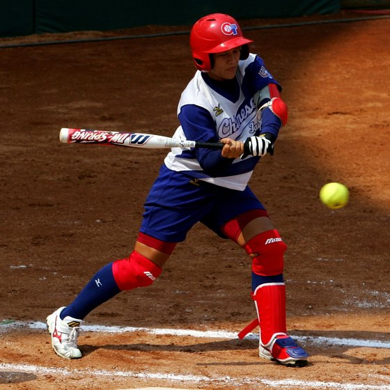 Swing a properly-sized bat to succeed in fast-pitch softball.