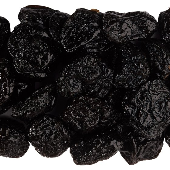 Pitted prunes, or dried plums, contain ample amounts of fiber and vitamin K.