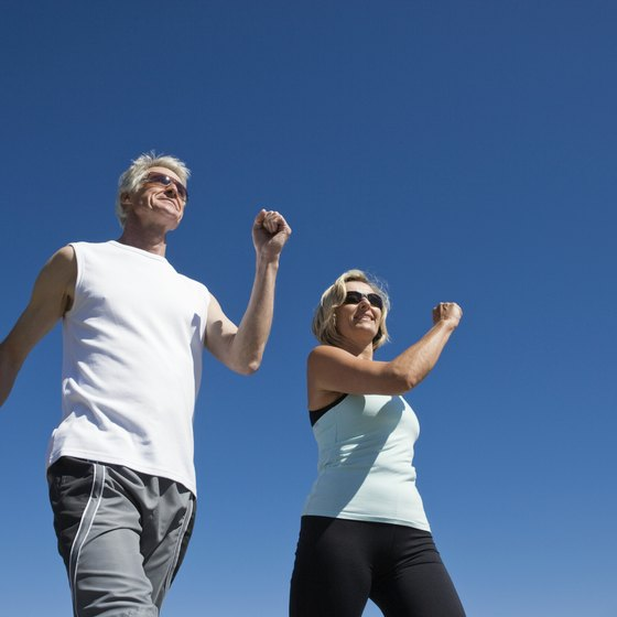 Power walking incorporates arm movements and a brisk pace to burn calories.