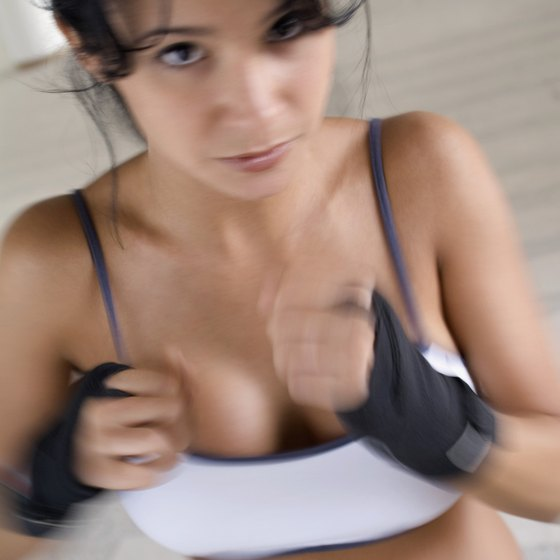 Many boxers hold small weights while shadow boxing to increase their hand speed.