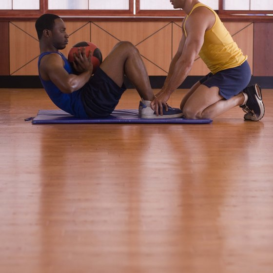 Throw a medicine ball against a rebounder for an excellent abdominal workout.