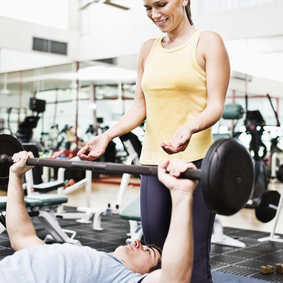 Using a spotter helps you work to muscle fatigue without fear of injury.