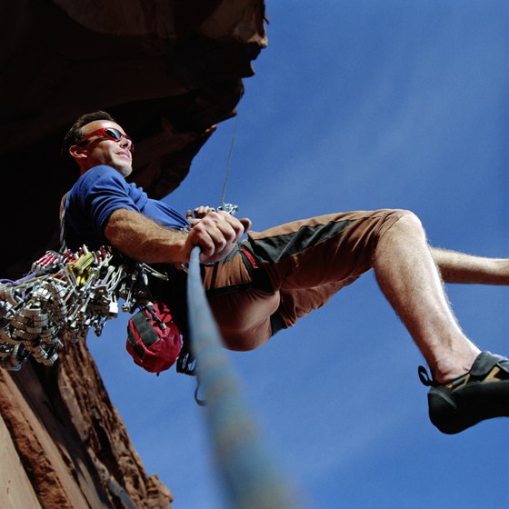 A climber uses a descender to lower himself to the ground.